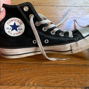 Worn black high top converse